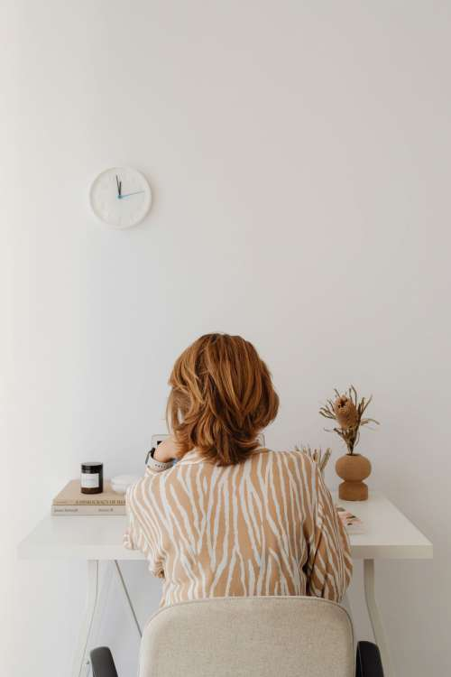 A woman works at her desk - home office