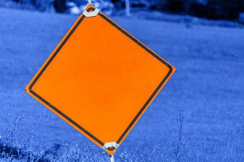Orange Caution Road Sign