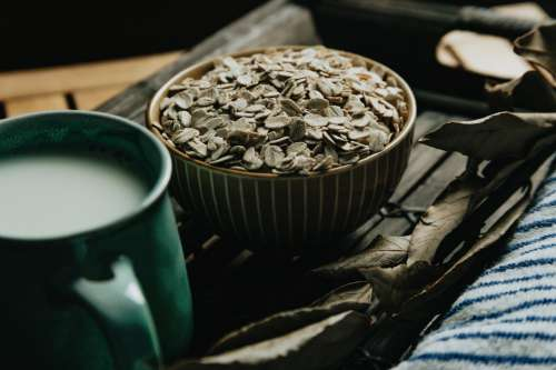 Bowl Of Oats And A Mug On A Wooden Tray Photo