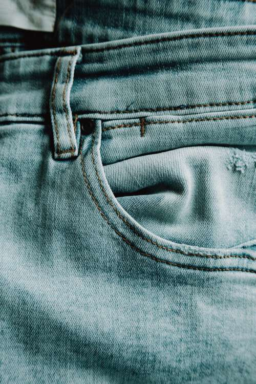 Close Up of The Pocket of Lite Blue Jeans Photo