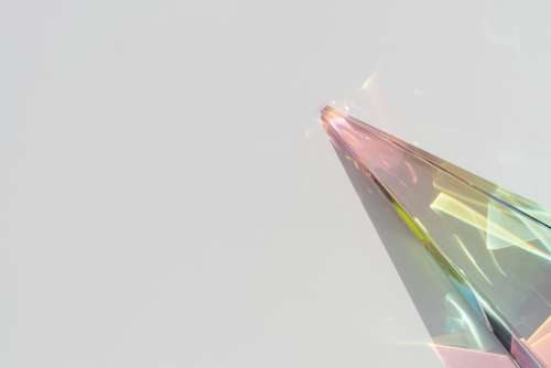 Rainbow spectrum in a glass prism with shadow