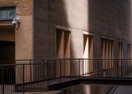 A Beam Of Light Strikes The Side Of A City Building Photo