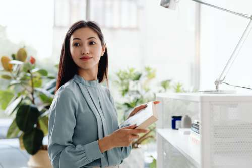 Young Asian Woman At Office