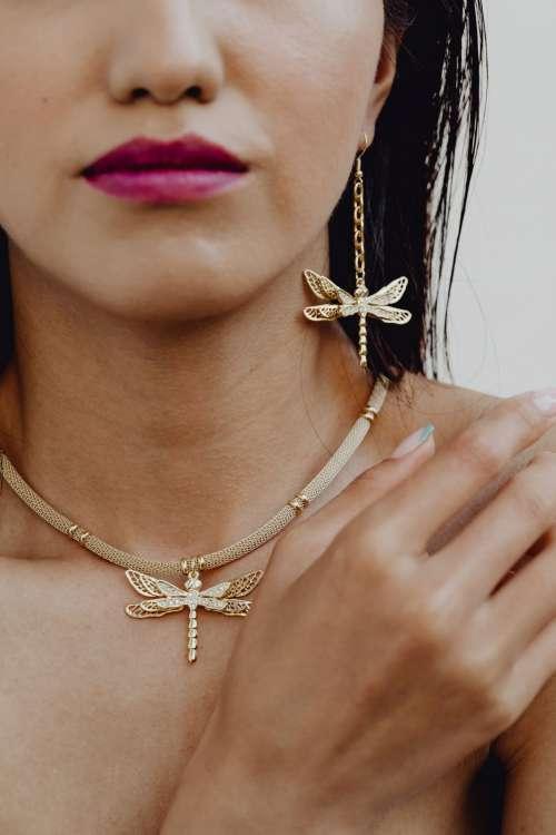 Beautiful Asian woman wears massive gold handmade jewelry